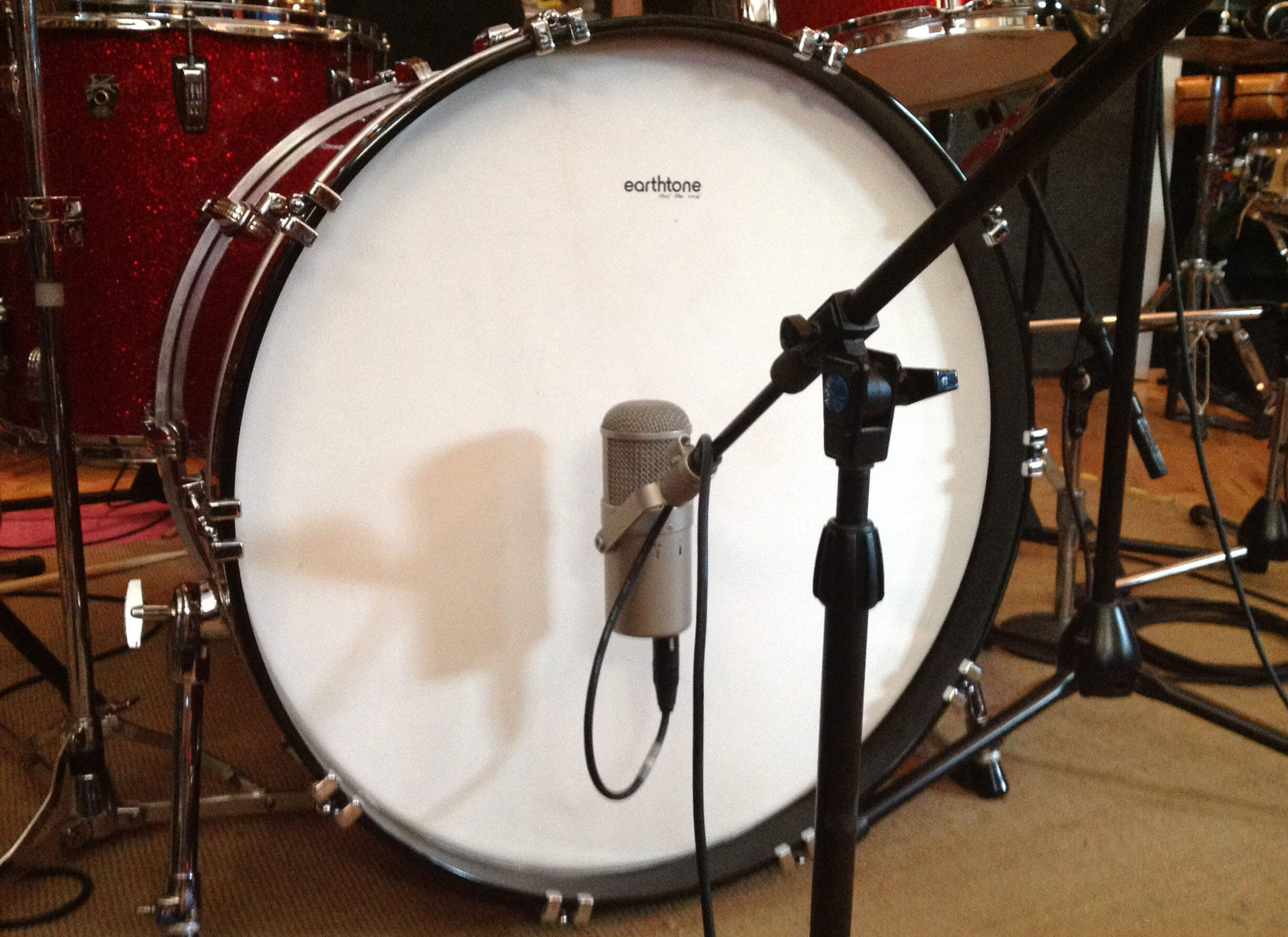An Earth Tone Drum Head mounted on a vintage bass drum